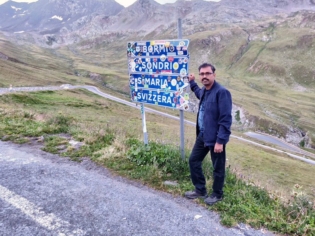 Man standing in Stelvio Pass Italy Swiss Border